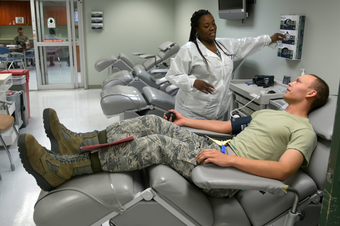 Tarissa Brown, 81st Diagnostics and Therapeutics Squadron lab technician, draws blood from U.S. Air Force Airman Igor Houston, 336th Training Squadron student, at the Blood Donor Center at Keesler Air Force Base, Mississippi, July 16, 2019. The Keesler Blood Donor Center provides blood to deployed service members. (U.S. Air Force photo by Airman Seth Haddix)