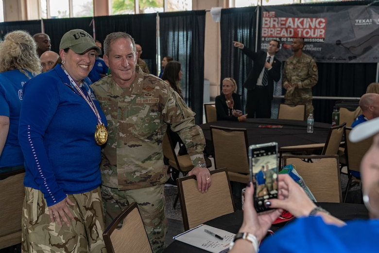 Air Force Chief of Staff Gen. David L. Goldfein and Tech Sgt. Roann R. Leatz, Team Air Force athlete, pose for a photo at the 2019 Department of Defense Warrior Games at Tampa, Fla, June 28, 2019. Warrior Games athletes have overcome significant physical and psychological challenges, not always visible to others and have demonstrated that life continues after becoming wounded, ill or injured. (U.S. Air Force photo by Tech Sgt. Lionel Castellano)