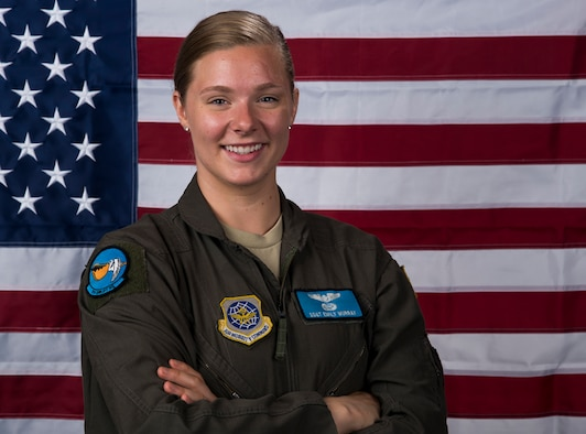 Staff Sgt. Emily Murray, 9th Airlift Squadron flight engineer, stands by the U.S. flag July 11, 2019, at Dover Air Force Base, Del. Murray traveled to Joint Base Langley to have her measurements taken, along with 60 other female aviators from the U.S. Air Force and the U.S. Navy. The measurements were taken because flight equipment is in the process of being redesigned to better fit female aviators. (U.S. Air Force photo by Senior Airman Christopher Quail)
