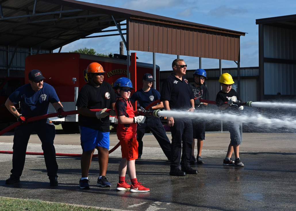 Junior firefighters learn the importance of fire safety.