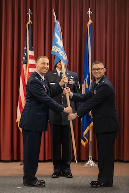 Col. Matthew Cantore, 21st Operations Group commander, passes the guidon to Lt. Col. Justin Sorice, 18th Space Control Squadron commander, during a change of command ceremony June 18, 2019 at Vandenberg Air Force Base, California. The mission of the 18th SPCS is to deliver foundational space situational awareness to assure global freedom of action in space. (U.S. Air Force courtesy photo)