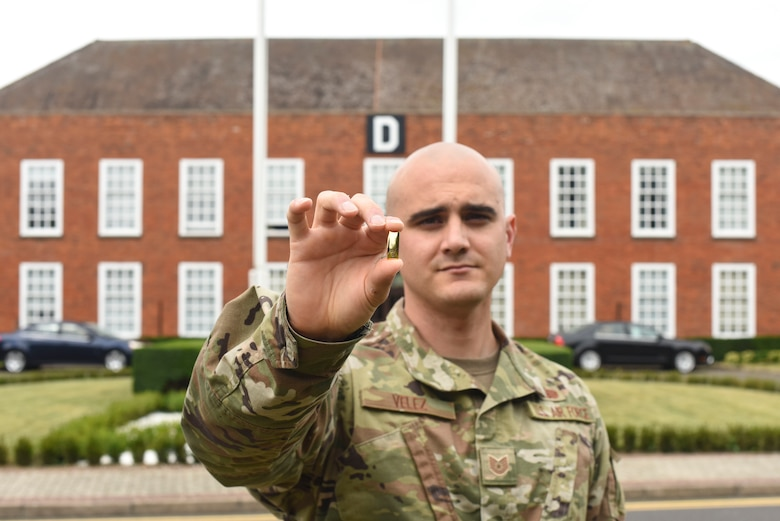 U.S. Air Force Tech. Sgt. Ian Velez, 100th Communications Squadron NCO-in-charge of radio frequency transmissions, displays a second lieutenant's bar at RAF Mildenhall, England, July 17, 2019. Velez earned his commission as an officer and will depart later this month to attend Officer Training School at Maxwell Air Force Base, Alabama. (U.S. Air Force photo by Airman 1st Class Joseph Barron)