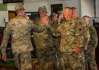 ILNG leadership high-five Soldiers following the Deployment Ceremony