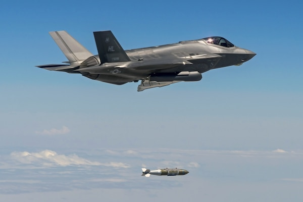 An F-35A Lightning II aircraft from Hill Air Force Base, Utah, drops a 2,000-pound GBU-31 bomb over the Utah Test and Training Range.