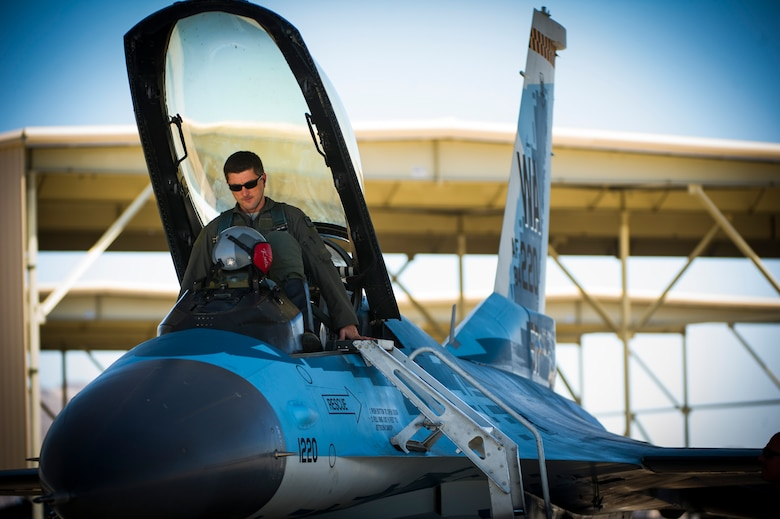 Lt. Col. Jan Stahl, 706th Fighter Squadron commander, positions himself inside an F-16 fighting falcon July 16, 2019, at Nellis Air Force Base, Nev. Red Flag focuses on the application of core missions to include Command and Control, Intelligence Surveillance, Strike and Personnel Recovery and how to work with Coalition counterparts to ensure success. The 706th Fighter Squadron oversees Air Force Reserve Command members assigned to the U.S. Air Force Warfare Center, supporting missions in its 57th Wing, 53rd Wing and 505th Command and Control Wing. Pilots assigned to the 706 FS fly an array of aircraft to include the F-15C, F-15E, F-16, F-22 and F-35 aircraft. To prepare combat air forces, joint and allied crews with realistic training, pilots in the 706 FS operate with the 64th Aggressor Squadron to facilitate operational threat replication, training, and feedback. The Red Flag exercise will continue through July 26, 2019.