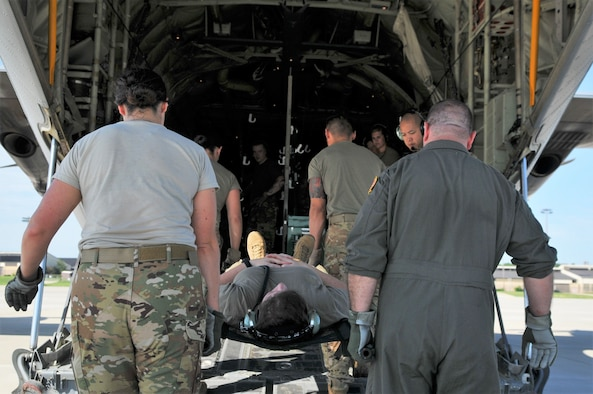 Pope's 43d Aeromedical Evacuation Squadron (AES) gets set to load the aircraft during a tandem Aeromedical Readiness Mission