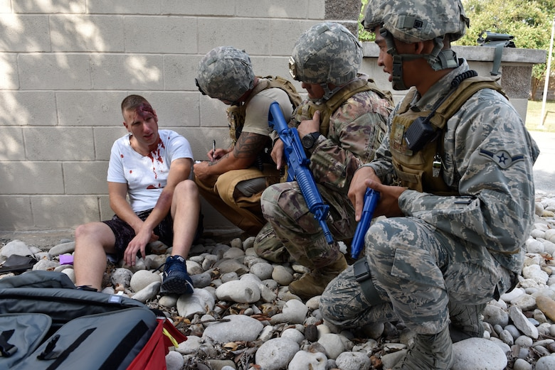 Members of the 47th Security Forces Squadron interviews a simulated active shooter victim during a training exercise at Laughlin Air Force Base, Texas, July 22, 2019. The exercise, aimed at bolstering crisis readiness and response capabilities, simulated a hostage situation that lasted for nearly two hours. (U.S. Air Force photo by Staff Sgt. Benjamin N. Valmoja)