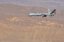 An MQ-9 Reaper, piloted from the ground by Maj. Stevo, MQ-9 instructor pilot, flies over the Nevada Test and Training Range, July 15, 2019. Remotely Piloted Aircraft Airmen are responsible for providing dominant, persistent attack capabilities for our nation and its allies across the globe. (U.S. Air Force photo by Senior Airman Haley Stevens)