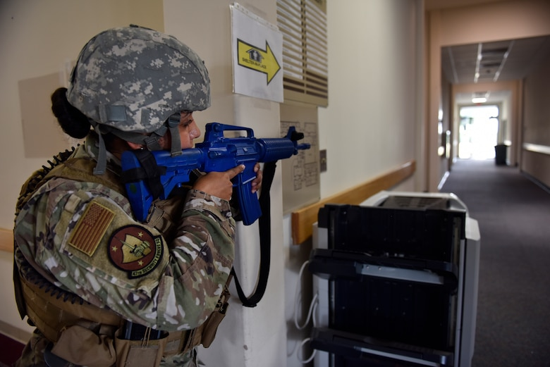 Staff Sgt. Desiree Gonzalez, 47th Security Forces Squadron police services NCO in charge, locks down an entry control point during a training exercise at Laughlin Air Force Base, Texas, July 22, 2019. The exercise, aimed at bolstering crisis readiness and response capabilities, simulated a hostage situation that lasted for nearly two hours. (U.S. Air Force photo by Staff Sgt. Benjamin N. Valmoja)
