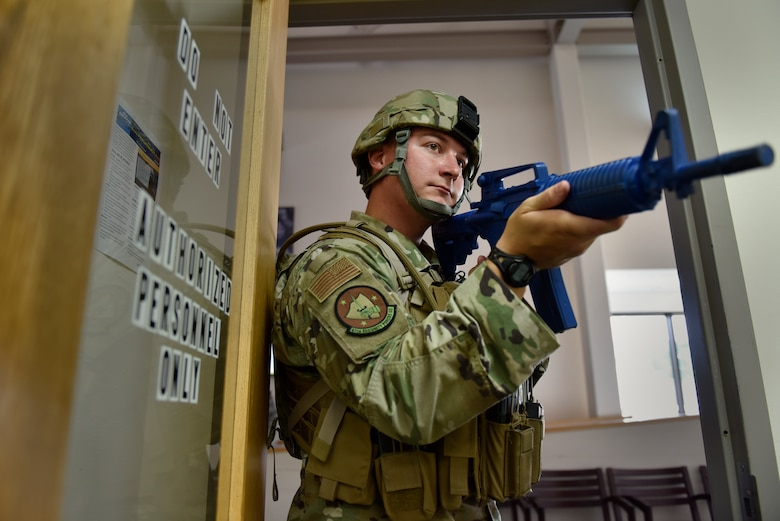 Senior Airman Alexander Larson stands watch during an active shooter training at Laughlin Air Force Base, Texas, July 22, 2019. The exercise, aimed at bolstering crisis readiness and response capabilities, simulated a hostage situation that lasted for nearly two hours. (U.S. Air Force photo by Staff Sgt. Benjamin N. Valmoja)