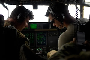 Two pilots prepare to fly C-130J