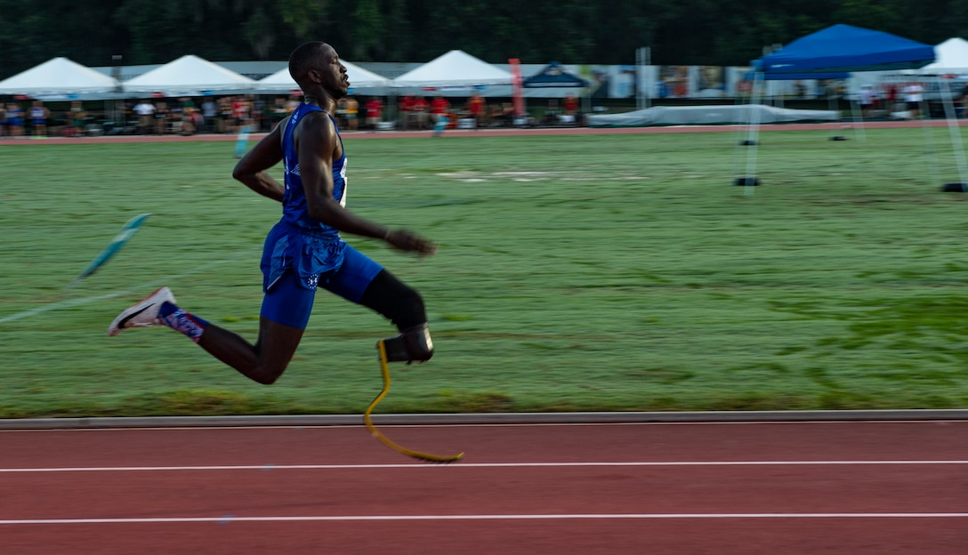 U.S. Air Force Staff Sgt. Kevin Greene, Team Air Force athlete, competes in the 200-meter dash during the Department of Defense Warrior Games track competition in Tampa, Fla., June 22, 2019. Approximately 300 U.S. military and international service members and veterans will participate in the 2019 Warrior Games. The athletes represent the U.S. Army, Marine Corps, Navy, Air Force and Special Operations Command. This year, athletes from the United Kingdom Armed Forces, Australian Defence Force, Canadian Armed Forces, the Netherlands Defence Force and the Danish Defence Force are also competing.(U.S. Air Force photo by Staff Sergeant James R. Crow)