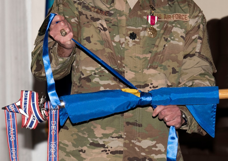 U.S. Air Force Lt. Col. Benjamin Clarke, former 20th Dental Squadron (DS) commander, rolls up the 20th DS guidon as part of the squadron's deactivation at Shaw Air Force Base, South Carolina, July 18, 2019.