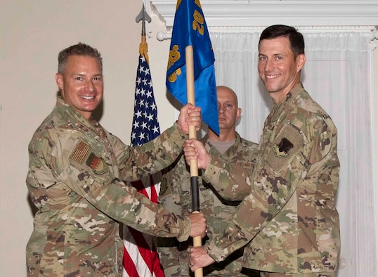 U.S. Air Force Lt. Col. Benjamin Gantt, 20th Operational Medical Readiness Squadron (OMRS) commander, right, assumes command of the 20th OMRS from Col. Christian Lyons, 20th Medical Group commander, at Shaw Air Force Base, South Carolina, July 18, 2019.
