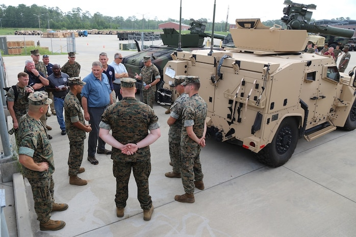 James Geurts, assistant secretary of the Navy for Research, Development and Acquisition, speaks to Marines July 17, while touring the Joint Light Tactical Vehicle fielding facility aboard Camp Lejeune, North Carolina. Program Executive Officer Land Systems is currently fielding the Corps' first infantry battalion—3rd Battalion, 8th Marines, 2nd Marine Division—with the vehicle. (U.S. Marine Corps photo by Ashley Calingo)