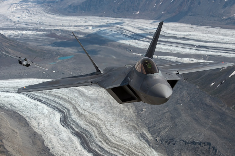 U.S. Air Force F-22 Raptors from Joint Base Elmendorf-Richardson, fly in formation over the Joint Pacific Alaska Range Complex, July 18, 2019.