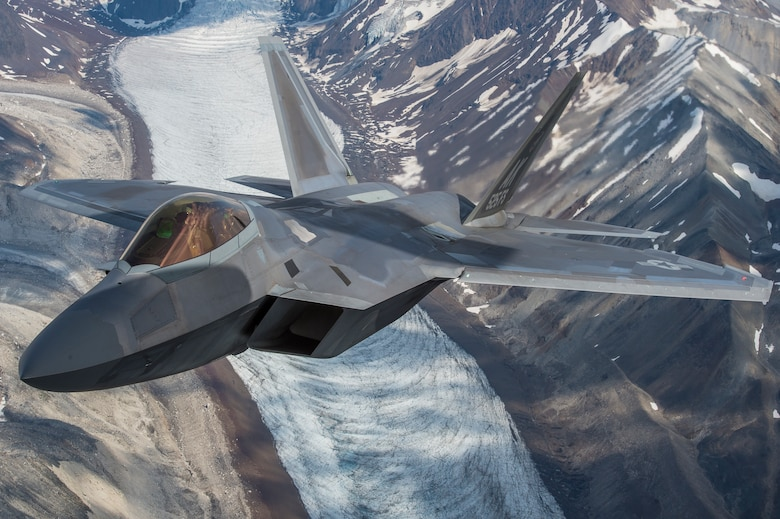 A U.S. Air Force F-22 Raptor from Joint Base Elmendorf-Richardson, flies in formation over the Joint Pacific Alaska Range Complex, July 18, 2019.