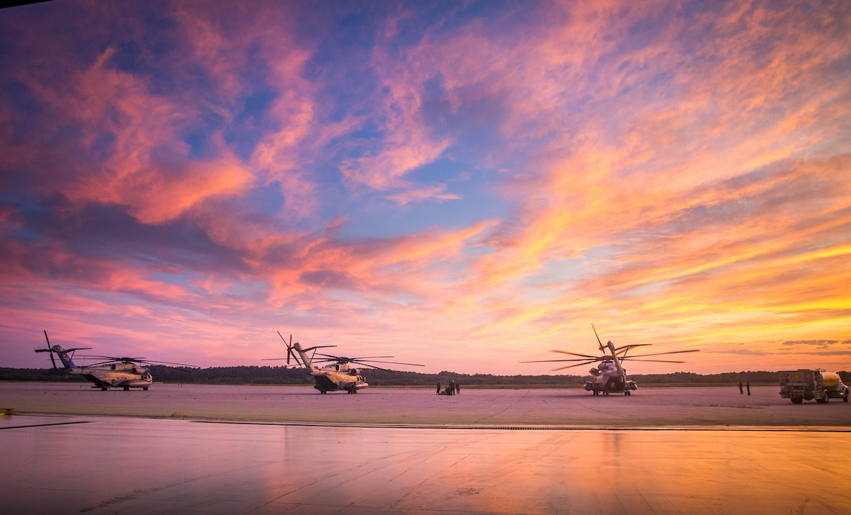 Three CH-53E Super Stallion's with Marine Heavy Helicopter Squadron 461, are stationary on the flight line in Brunswick, Maine, July 17, 2019. The purpose of HMH-461's deployment for training is to increase the squadron's proficiency in mountainous terrain operations, to conduct mission essential tasks in a challenging environment, and improve combat readiness.