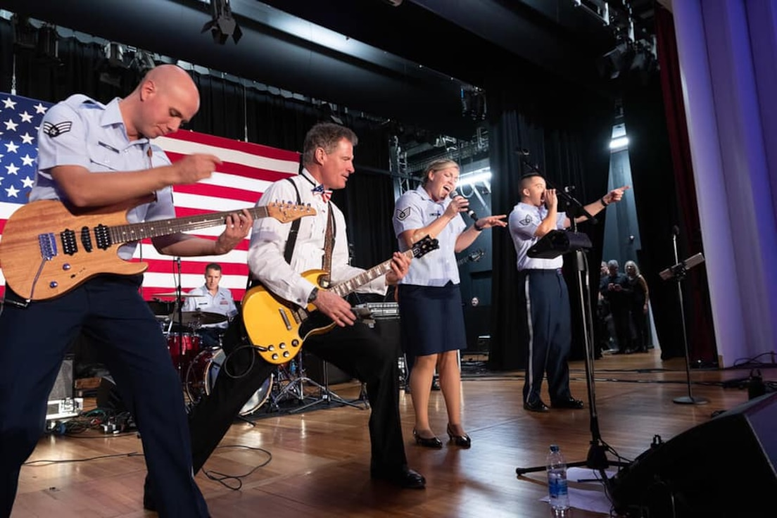 The US Ambassador to New Zealand, The Honorable Scott Philip Brown, joins Small Kine on stage for an electric performance during the US Embassys Independence day Celebrations.
