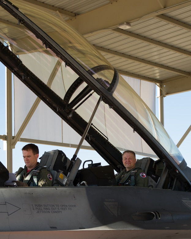 Lt. Col. Kenneth Seiver, a 457th Fighter Squadron F-16 pilot, completes a familiarization flight for Chief Master Sgt. James Loper, 10th Air Force command chief, at Naval Air Station Fort Worth Joint Reserve Base, Texas on July 12, 2019. The flight gave Loper a hands-on understanding of the jet's capabilities and the squadron's mission. (U.S. Air Force photo by Senior Airman Randall Moose)