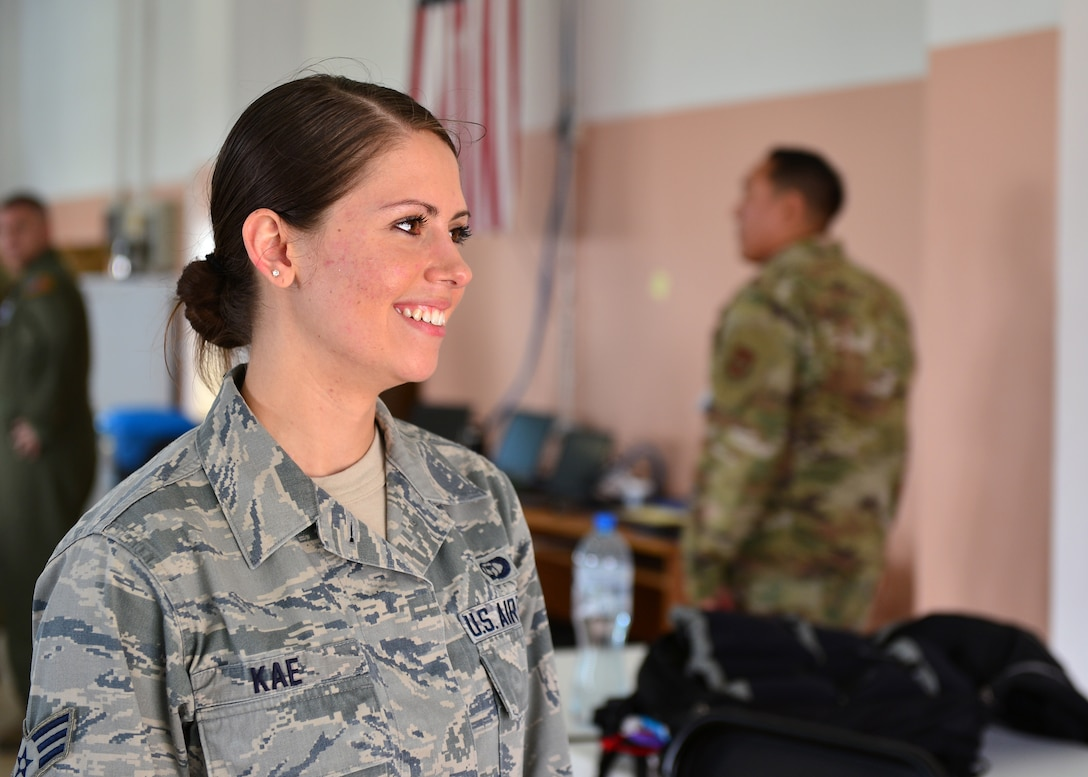 U.S. Air Force Senior Airman Julie Kae, 86th Operations Support Squadron weather forecaster, participates in an interview at Powidz Air Base, Poland, July 10, 2019. Kae was the sole forecaster deployed with the 37th Airlift Squadron in support of Aviation Rotation 19-3 and was responsible for conducting research, consolidating weather information, and briefing aircrew members before flights. (U.S. Air Force photo by Staff Sgt. Jimmie D. Pike)