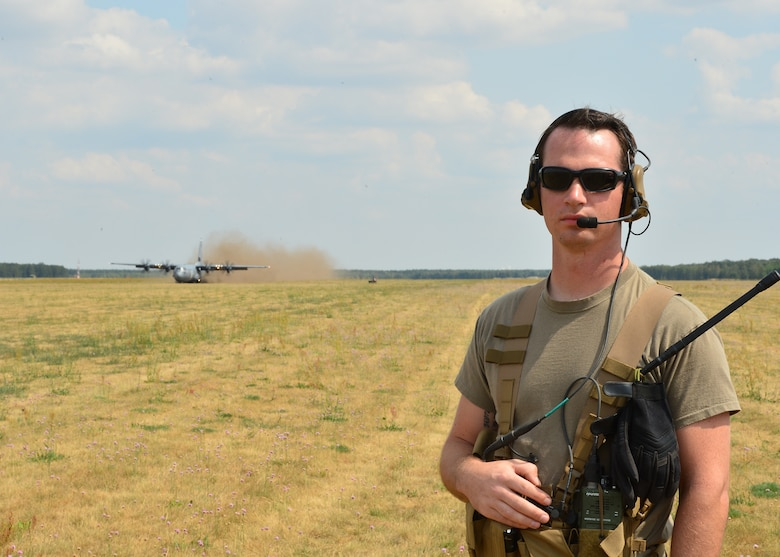 U.S. Air Force Staff Sgt. David Valine, 435th Contingency Response Squadron landing zone safety officer, provides control support for Airmen deployed in support of Aviation Rotation 19-3 at Powidz Air Base, Poland, July 20, 2019. Landing zone safety officers set up landing strips, communicate with incoming aircraft, and ensure the integrity of the landing area for a safe arrival of aircraft. (U.S. Air Force photo by Staff Sgt. Jimmie D. Pike)