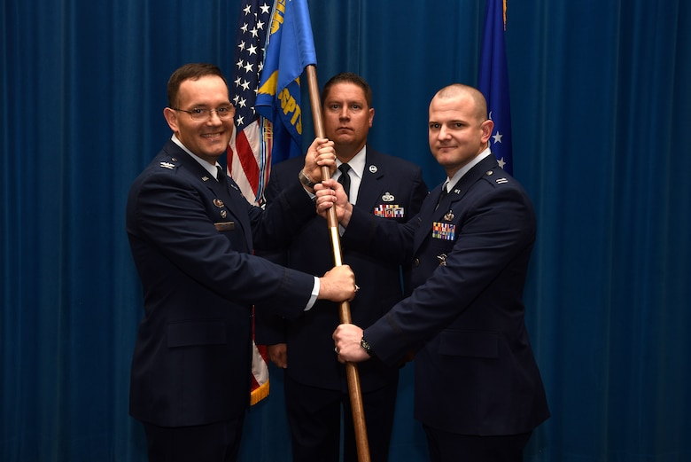 U.S. Air Force Capt. Rudolph McIntyre IV accepts the guidon and command of the 377th Security Support Squadron from Col. Theodore Breuker, 377th Security Forces Group commander, in an assumption of command ceremony at Kirtland Air Force Base, N.M., July 23, 2019. McIntyre comes from Spangdahlem Air Base, Germany, where he was the anti-terrorism officer for the 52nd Fighter Wing. (U.S. Air Force photo by Airman 1st Class Austin J. Prisbrey)
