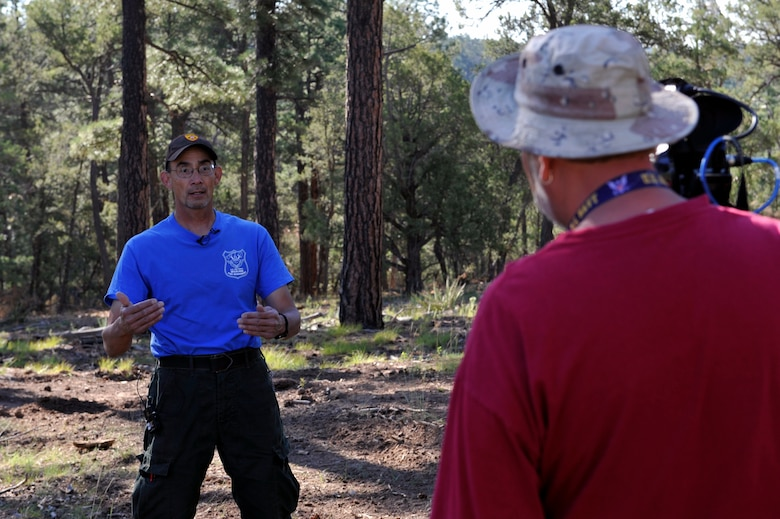 Robert Morales, Kirtland's Wildland Support Module lead, answers media questions during a media day in the eastern-most remote forest area of Kirtland Air Force Base, N.M., July 18, 2019. The team of six wildland firefighters have thinned out 70 acres of forest expanding on the initial fuel breaks that were created since the project broke ground in spring of 2019.  (U.S. Air Force photo by Staff Sgt. Dylan Nuckolls)