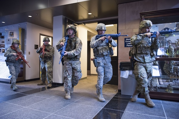 SCHRIEVER AIR FORCE BASE, Colo.--50th Security Force Squadron response force team moves to clear a building in a simulated active shooter scenario during a field training exercise at Schriever Air Force Base, Colorado, July 20, 2019. The FTX consisted of a simulated gate crash, a series of active shooters scenarios throughout the base and a squadron recall to test their mobilization.  (U.S. Air Force photo by Staff Sgt. Matthew Coleman-Foster)
