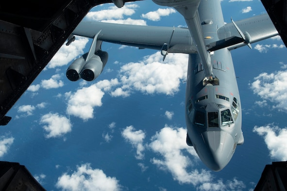 A U.S. Air Force B-52 Stratofortress is refueled by a USAF KC-10 Extender July 14, over the Pacific Ocean near the coast of Brisbane, Australia, in support of Exercise Talisman Sabre 19. The Stratofortress and Extender were some of several aircraft used during TS19,  alongside other USAF and RAAF airborne warning and control system aircraft, refuelers, tankers and bombers.(U.S. Air Force photo by Senior Airman Elora J. Martinez)