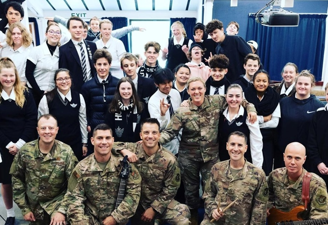 The members of Small Kine pose for a photo with the students of Hutt Valley High School in Wellington, New Zealand.