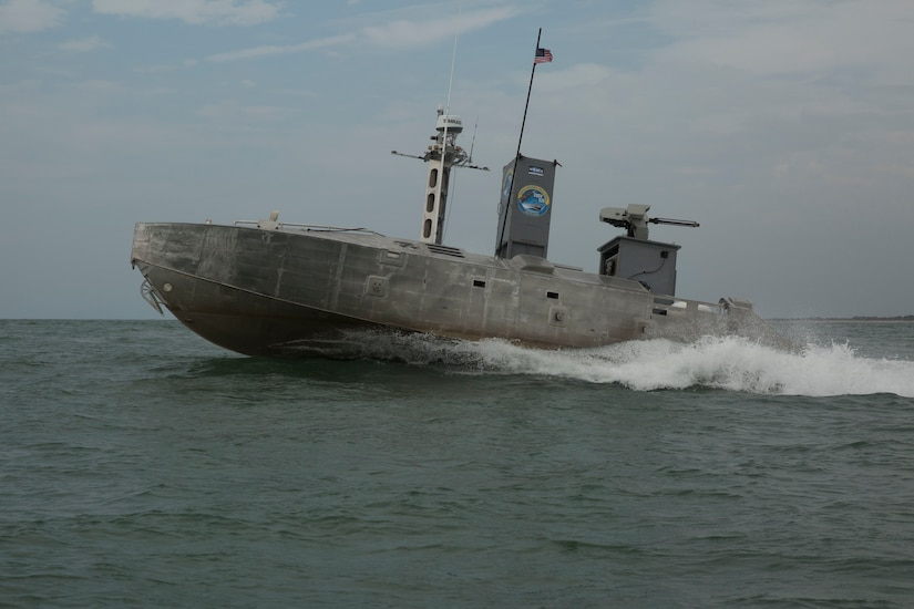 An Expeditionary Warfare Unmanned Surface Vessel autonomously navigates a predetermined course through the water during Advanced Naval Technology Exercise 2019 at Camp Lejeune, N.C. July 12, 2019. ANTX East 2019 is an event designed to test new technology with acedemic, industry and Navy participants. (Marine Corps photo by LCpl. Nicholas Guevara)