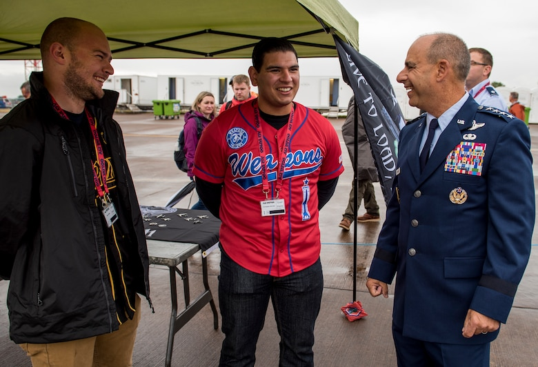 U.S. Air Force Senior Airman Ryan Golden, 48th Aircraft Maintenance Squadron support technician, and Christopher Morejon, 48th Maintenance Group weapons lead load crew member, meet Gen. Jeff Harrigian, U.S. Air Forces in Europe and Air Forces Africa commander, during the 2019 Royal International Air Tattoo at RAF Fairford, England, July 19, 2019. This year's RIAT commemorated the 70th anniversary of NATO and highlighted the United States' enduring commitment to its European allies. (U.S. Air Force photo by Airman 1st Class Jennifer Zima)