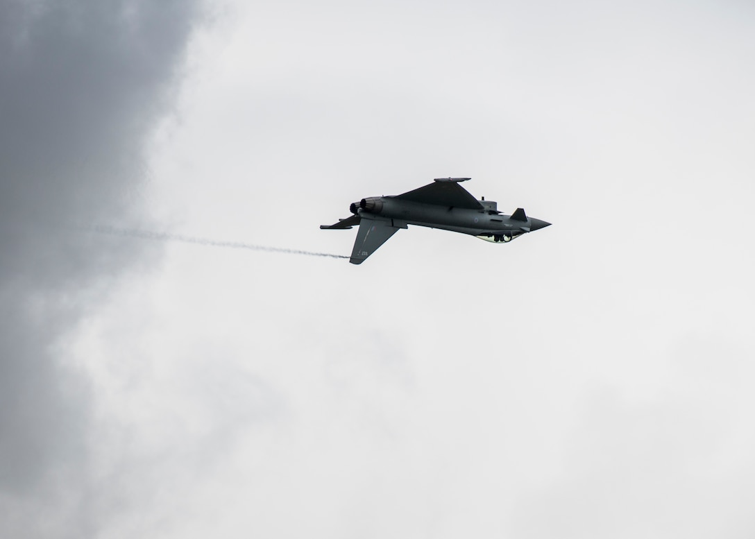 An Italian Air Force Eurofighter F-2000 Typhoon flies past the audience during the 2019 Royal International Air Tattoo at RAF Fairford, England, July 20, 2019. This year, RIAT commemorated the 70th anniversary of NATO and highlighted the United States' enduring commitment to its European allies. (U.S. Air Force photo by Airman 1st Class Jennifer Zima)