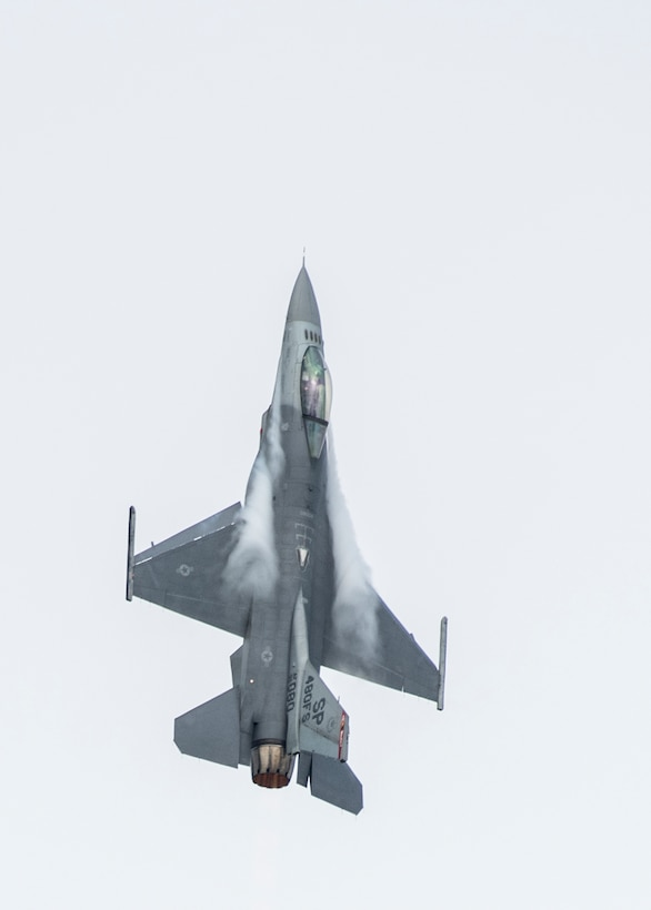 A member of the U.S. Air Force's F-16 Viper Demonstration Team flies vertically during the 2019 Royal International Air Tattoo at RAF Fairford, England, July 20, 2019. This year, RIAT commemorated the 70th anniversary of NATO and highlighted the United States' enduring commitment to its European allies. (U.S. Air Force photo by Airman 1st Class Jennifer Zima)