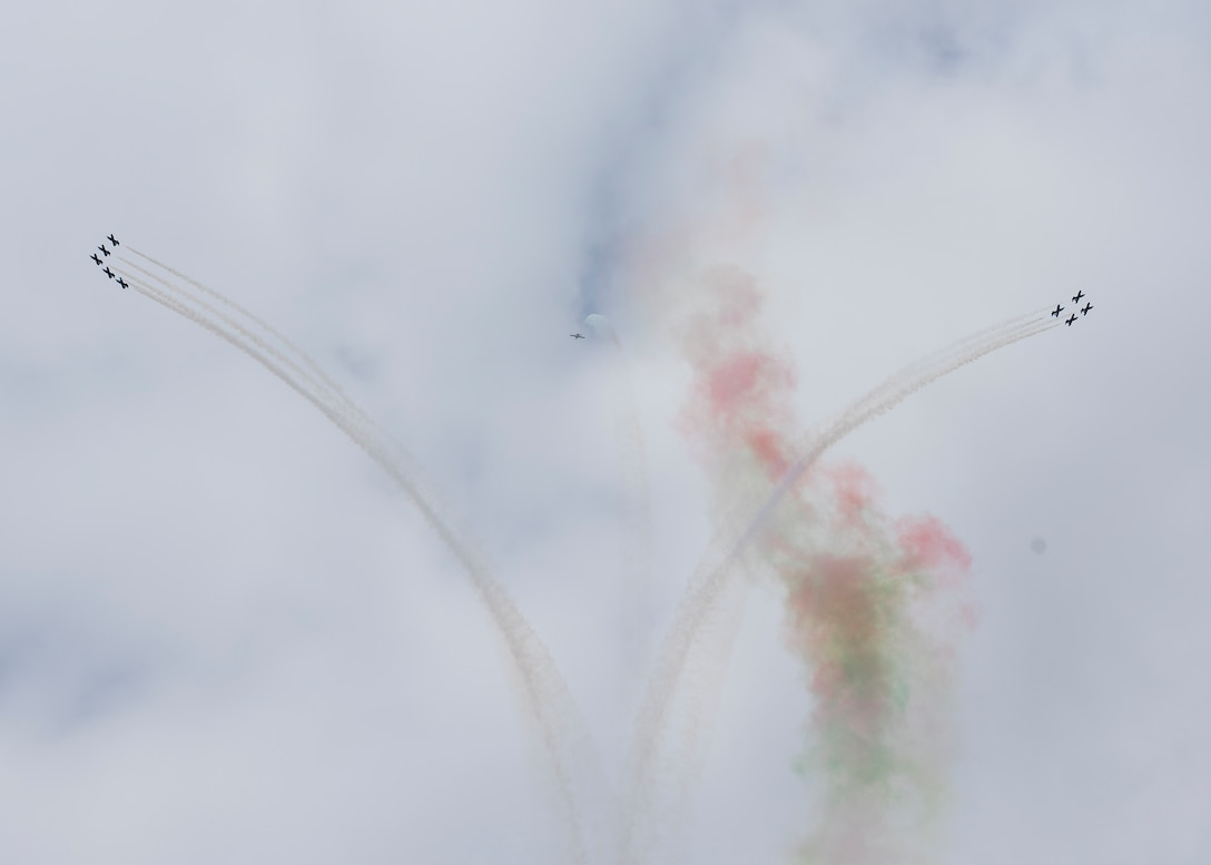 Several members of the Italian Air Force's Frecce Tricolori aerobatic team conduct aerial maneuvers during the 2019 Royal International Air Tattoo at RAF Fairford, England, July 20, 2019. This year, RIAT commemorated the 70th anniversary of NATO and highlighted the United States' enduring commitment to its European allies. (U.S. Air Force photo by Airman 1st Class Jennifer Zima)