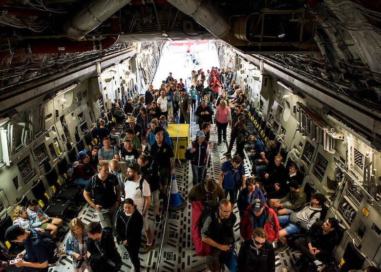 U.S. Air Force service members from the 315th Airlift Wing host tours for the public inside a C-17 Globemaster III on static display from Charleston Air Force Base, South Carolina, during the 2019 Royal International Air Tattoo at RAF Fairford, England, July 20, 2019. This year's RIAT commemorated the 70th anniversary of NATO and highlighted the United States' enduring commitment to its European allies. (U.S. Air Force photo by Airman 1st Class Jennifer Zima)