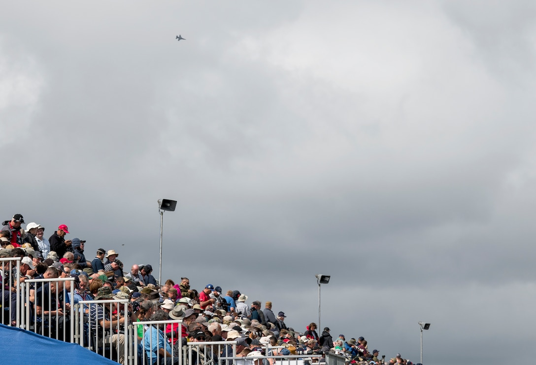 Thousands of attendees watch the aerial demonstrations during the 2019 Royal International Air Tattoo at RAF Fairford, England, July 20, 2019. This year's RIAT commemorated the 70th Anniversary of NATO and highlighted the United State's enduring commitment to its European allies. (U.S. Air Force photo by Airman 1st Class Jennifer Zima)