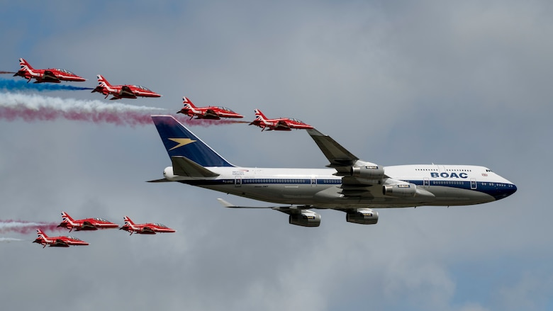 The Royal Air Force's Red Arrows and a British Airways Boeing 747-436 conduct a flypast during the 2019 Royal International Air Tattoo at RAF Fairford, England, July 20, 2019. This year, RIAT commemorated the 70th anniversary of NATO and highlighted the United States' enduring commitment to its European allies. (U.S. Air Force photo by Airman 1st Class Jennifer Zima)