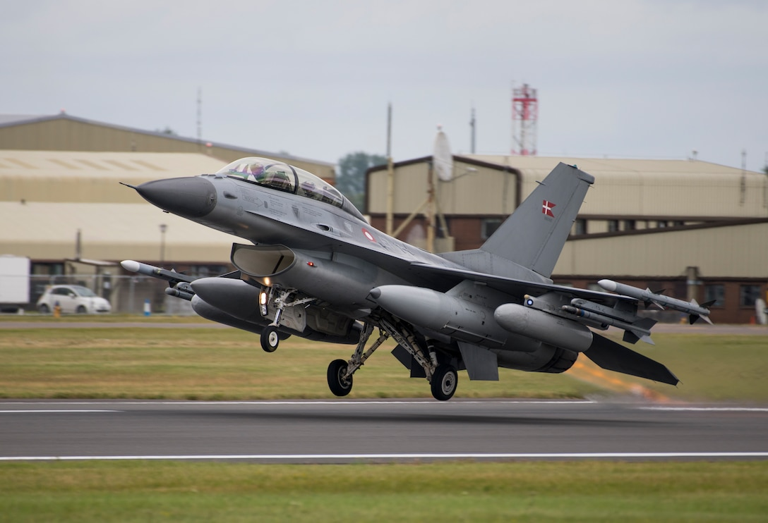 A Danish Air Force General Dynamics F-16AM/BM Fighting Falcon takes off from the runway at the 2019 Royal International Air Tattoo at RAF Fairford, England, July 20, 2019. This year, RIAT commemorated the 70th anniversary of NATO and highlighted the United States' enduring commitment to its European allies. (U.S. Air Force photo by Airman 1st Class Jennifer Zima)