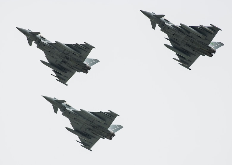 Royal Air Force Eurofighter Typhoons fly past the audience during the 2019 Royal International Air Tattoo at RAF Fairford, England, July 20, 2019. This year, RIAT commemorated the 70th anniversary of NATO and highlighted the United States' enduring commitment to its European allies. (U.S. Air Force photo by Airman 1st Class Jennifer Zima)