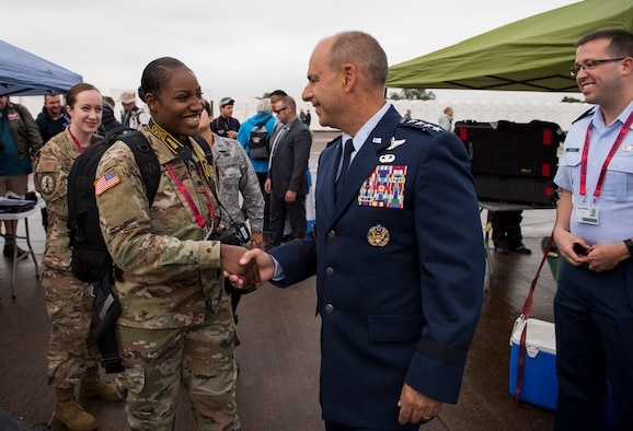U.S. Army Spc. Jillita Grier-Watford, Armed Forces Network Europe broadcaster, meets Gen. Jeff Harrigian, U.S. Air Forces in Europe and Air Forces Africa commander, conducts an interview during the 2019 Royal International Air Tattoo at RAF Fairford, England, July 19, 2019. This year's RIAT commemorated the 70th anniversary of NATO and highlighted the United States' enduring commitment to its European allies. (U.S. Air Force photo by Airman 1st Class Jennifer Zima)