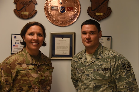 U.S. Air Force Maj. Candee Berck, 39th Medical Operations Squadron Alcohol and Drug Abuse Prevention and Treatment program manager, left, and Staff Sgt. Aidan Vela, 39th MDOS mental health technician, pose for a photo, July 18, 2019, at Incirlik Air Base, Turkey. ADAPT is one of the entities that fall under the mental health flight and is in place as a preventative and rehabilitative program to get Airmen focused on their mission. (U.S. Air Force photo by Staff Sgt. Matthew J. Wisher)