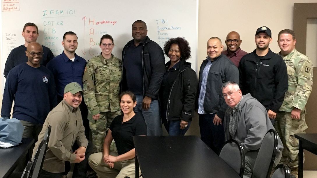 DLA's Joint Contingency Acquisition Support Office is recruiting members for its Expeditionary Contracting Cadre to assist military and civilian customers around the world. Current cadre members pose for a picture during training. They are (back row, left to right): Jason Taylor, DLA Distribution; Anthony Sabatina, DLA Contracting Services Office; Camp Atterbury instructor; Marlon Grant, DLA Strategic Materials; Valerie Nibblins, JCASO; Jose Vasquez, DLA Energy; Hiram Banuchi, DLA Aviation Huntsville; Jacob Curtiss, DLA Disposition; Camp Atterbury instructor; (middle row) Timothy Weatherspoon, DLA Energy; (front row, left to right) Efrain Acevedo Santiago, DLA Aviation Huntsville; Emely Reamsnyder, JCASO; and Leonard Hatton, DLA Disposition. Courtesy photo