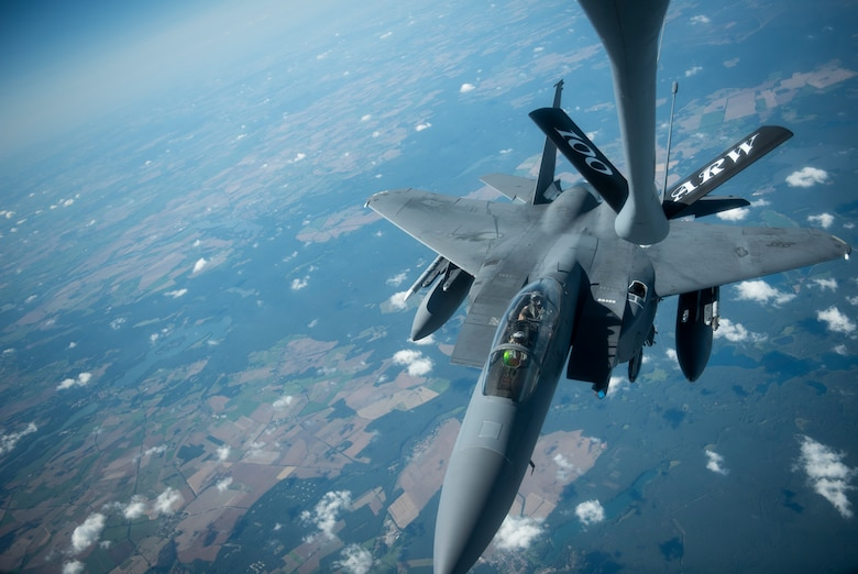 A U.S. Air Force F-15E Strike Eagle, assigned to the 4th Fighter Wing, Seymour Johnson Air Force Base, North Carolina, approaches a KC-135 Stratotanker assigned to the 351st Air Refueling Squadron, RAF Mildenhall, England, to receive fuel during Operation Rapid Forge over Germany, July 23, 2019. Rapid Forge is a U.S. Air Forces in Europe-sponsored training event designed to enhance interoperability with NATO allies and partners, improve readiness and sharpen operational capabilities. (U.S. Air Force photo by Tech. Sgt. Emerson Nuñez)