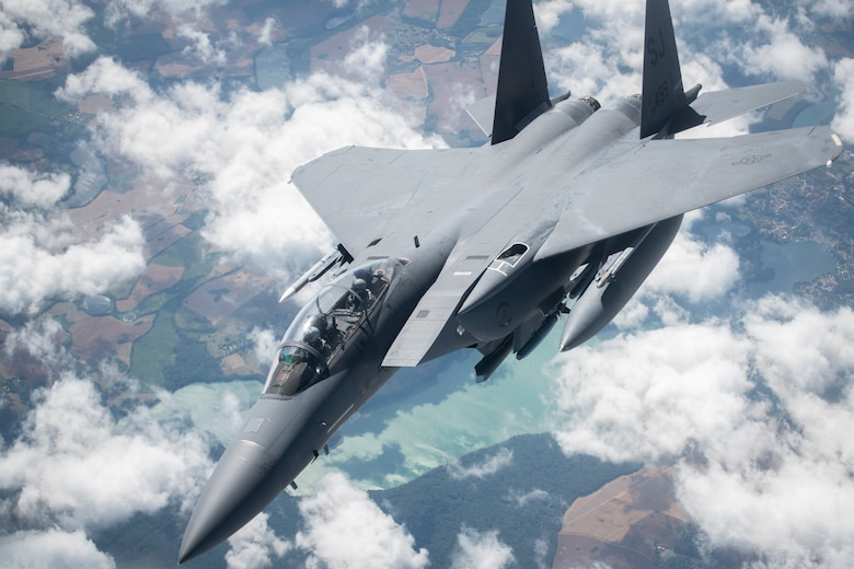 A U.S. Air Force F-15E Strike Eagle, assigned to the 4th Fighter Wing, Seymour Johnson Air Force Base, North Carolina, flies away from a KC-135 Stratotanker assigned to the 351st Air Refueling Squadron, RAF Mildenhall, England, after receiving fuel during Operation Rapid Forge over Germany, July 23, 2019. Rapid Forge aircraft are forward deploying to bases in the territory of NATO allies in order to enhance readiness and improve interoperability. The goal of the operation is to enhance readiness in coordination with U.S. allies and partners in Europe. (U.S. Air Force photo by Tech. Sgt. Emerson Nuñez)