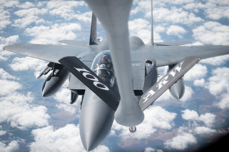A U.S. Air Force F-15E Strike Eagle, assigned to the 4th Fighter Wing, Seymour Johnson Air Force Base, North Carolina, approaches a KC-135 Stratotanker assigned to the 351st Air Refueling Squadron, RAF Mildenhall, England, to receive fuel during Operation Rapid Forge over Germany, July 23, 2019. Participation in multinational operations and operations like Rapid Forge enhances professional relationships and improves coordination between allies. (U.S. Air Force photo by Tech. Sgt. Emerson Nuñez)