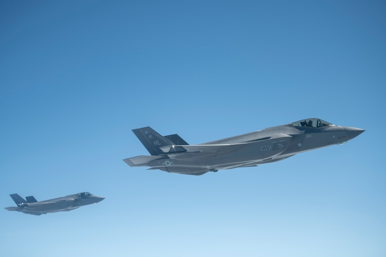 U.S. Air Force F-35A Lightning II aircraft  assigned to the 388th Fighter Wing, Hill Air Force Base, Utah, wait to receive fuel from a KC-135 Stratotanker assigned to the 351st Air Refueling Squadron, RAF Mildenhall, England, during Operation Rapid Forge over Germany, July 23, 2019.  Rapid Forge aircraft are forward deploying to bases in the territory of NATO allies. Participation in multinational operations enhances the U.S. Air Force's professional relationship with partner militaries. (U.S. Air Force photo by Tech. Sgt. Emerson Nuñez)