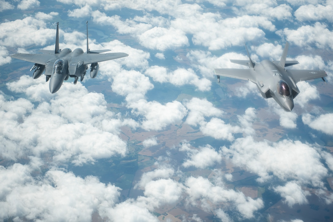 A U.S. Air Force F-15E Strike Eagle, assigned to the 4th Fighter Wing, Seymour Johnson Air Force Base, North Carolina, and a U.S. Air Force F-35A Lightning II assigned to the 388th Fighter Wing, Hill Air Force Base, Utah, fly side-by-side behind a KC-135 Stratotanker assigned to the 351st Air Refueling Squadron, RAF Mildenhall, England, during Operation Rapid Forge over Germany, July 23, 2019. Rapid Forge is a U.S. Air Forces in Europe-sponsored training event designed to enhance interoperability with NATO allies and partners, improve readiness and sharpen operational capabilities. (U.S. Air Force photo by Tech. Sgt. Emerson Nuñez)