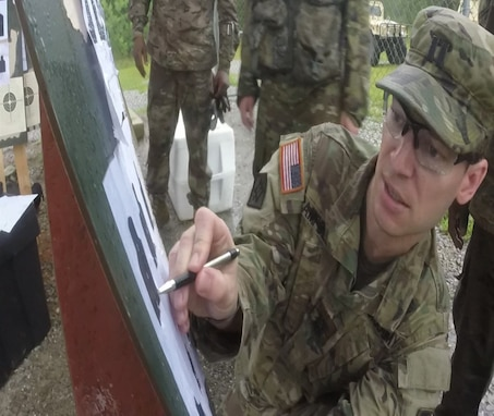 Cpt. Jesse Campbell (412th TEC, G3) scores Postal Match targets